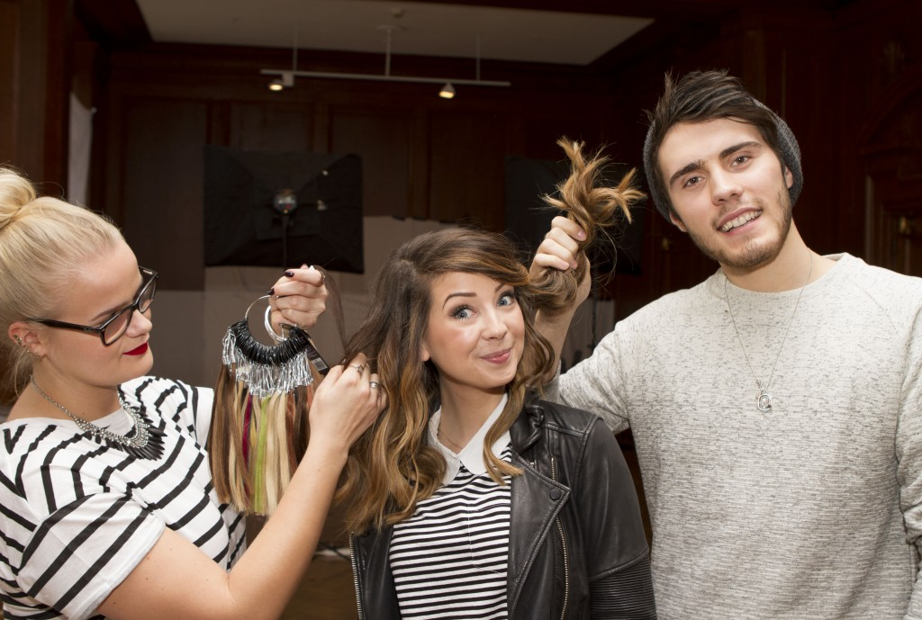 Madame Tussauds London Hair Stylist matches the colour of Zoella's hair for her wax figure